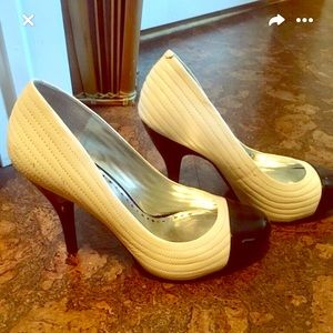 BCBG leather cream colored with black toe pumps
